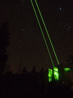 First ARGOS laser propagation at the LBT into the skies above Arizona. Powerful green, pulsed lasers create artificial guide stars for adaptive optics.