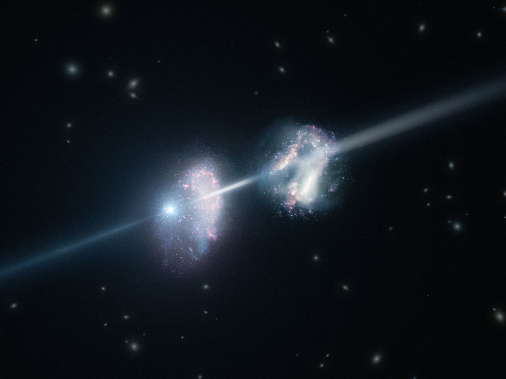 This artist's impression shows two galaxies in the early Universe. The brilliant explosion on the left is a gamma-ray burst. The light from the burst travels through both galaxies on its way to Earth (outside the frame to the right). Analysis of observations of the light from this gamma-ray burst made using ESO's Very Large Telescope have shown that these two galaxies are remarkably rich in heavier chemical elements.