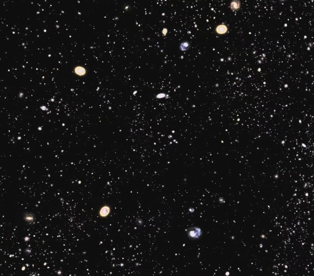<p>A still image from a video fly-through of the SDSS-III galaxies mapped in Data Release 9. (You can find the video on the SDSS press release site - for a link see right column.) Galaxies are concentrated into clusters and filaments with voids in between. The SDSS-III is exploring this structure to determine the nature of dark energy and the distribution of dark matter in the Universe.</p>