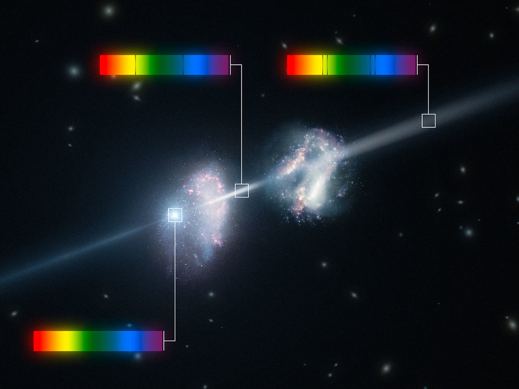 Artist's impression of a gamma-ray burst shining through two young galaxies in the early Universe.