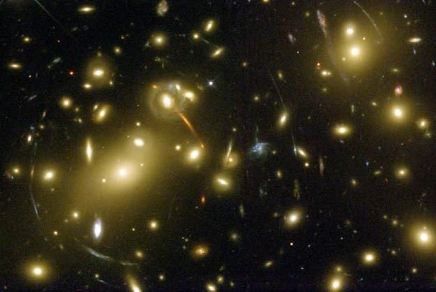 We determine the dark matter distribution in elliptical galaxies through dynamical modeling. Furthermore, we weigh dark matter halos through their lensing effect. We also analyze the lensing effect of clusters of galaxies and large scale structure.
