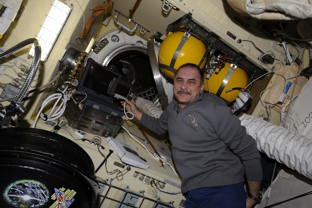 Cosmonaut Pavel Vinogradov operated the control computer for the PK-3 Plus laboratory on the ISS in June 2013. Front left, the container housing the laboratory.