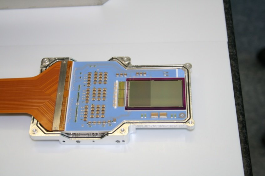 eROSITA detector integrated in the housing. Mounted on the right-hand side of the blue detector board is the CCD chip (384 x 384 pixels with pixel size of 75 x 75 µm<sup>2</sup>), while the electrical interface to the camera electronics is attached on the left-hand side.