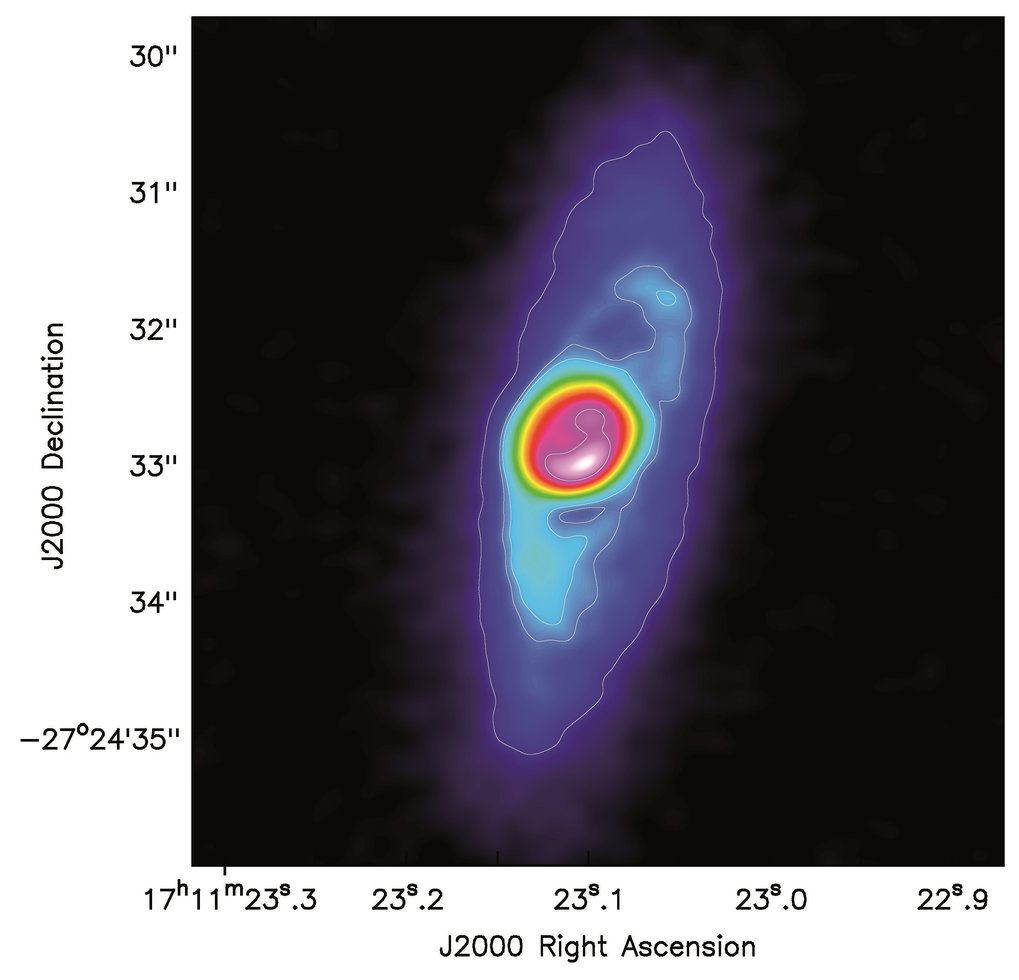 <p>This radio image obtained with ALMA shows the intensity of the dust continuum emission of BHB07-11. The contrast between the disk and the envelope including spirals is clearly visible.</p>