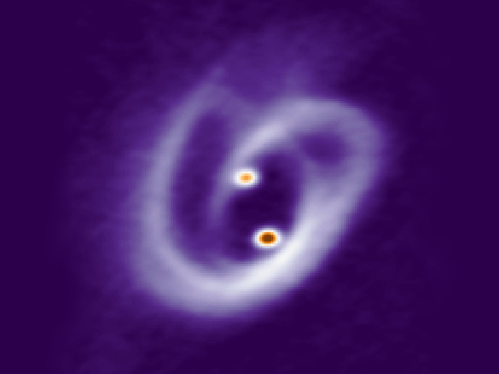 High-resolution images of a young stellar binary system for the first time reveal a complex network of accretion filaments nurturing two proto-stars at the centre of the circum-binary disk. With these observations, an international team of astronomers led by the Max Planck Institute for Extraterrestrial Physics was able to identify a two-level accretion process, circum-binary disk to circumstellar disk to stars, constraining the conditions leading to the formation and evolution of binary star systems.