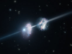 "<span class=""small"">This artist's impression shows two galaxies in the early Universe. The brilliant explosion on the left is a gamma-ray burst. The light from the burst travels through both galaxies on its way to Earth (outside the frame to the right). Analysis of observations of the light from this gamma-ray burst made using ESO's Very Large Telescope have shown that these two galaxies are remarkably rich in heavier chemical elements. </span>"